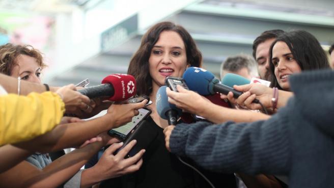 La presidenta de la Comunidad de Madrid, Isabel Díaz Ayuso ofrece declaraciones a los medios de comunicación, en la celebración del Día de la Policía, con motivo de la festividad de los Santos Ángeles Custodiosos, en Madrid