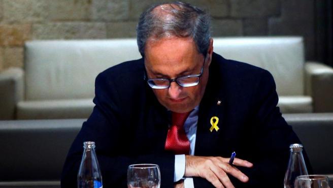 El presidente de la Generalitat, Quim Torra, durante la reunión que ha mantenido con su vicepresidente, Pere Aragonés, y los alcaldes de Girona, Tarragona y Lleida.