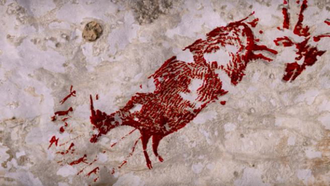 Pintura rupestre hallada en Indonesia.