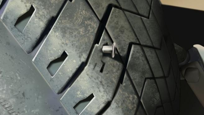Foto de un clavo en una rueda del coche.