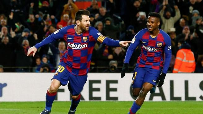 Messi celebra con Ansu Fati el tanto de la victoria ante el Granada.
