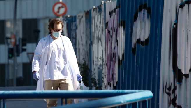 Illustration, sanitary in mask walks near to the Hospital de la Paz during the second week after the Government declared the state of alarm in Spain and recommended people to stay at home to fight coronavirus COVID-19 on March 26, 2020 in Madrid, Spain