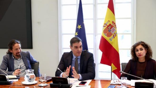 Pablo Iglesias, Pedro Sánchez y María Jesús Montero, en un Consejo de Ministros.