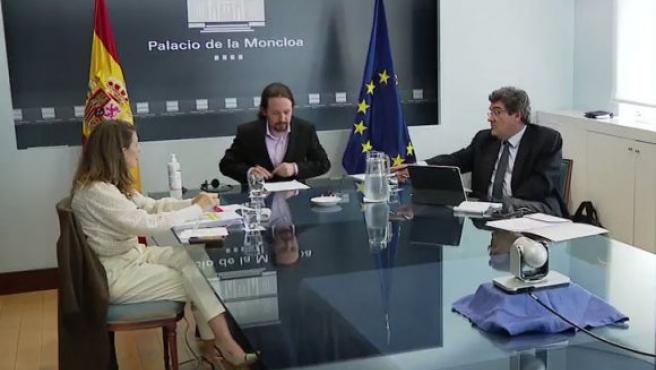 Los ministros José Luis Escrivá, Pablo Iglesias y Yolanda Díaz.