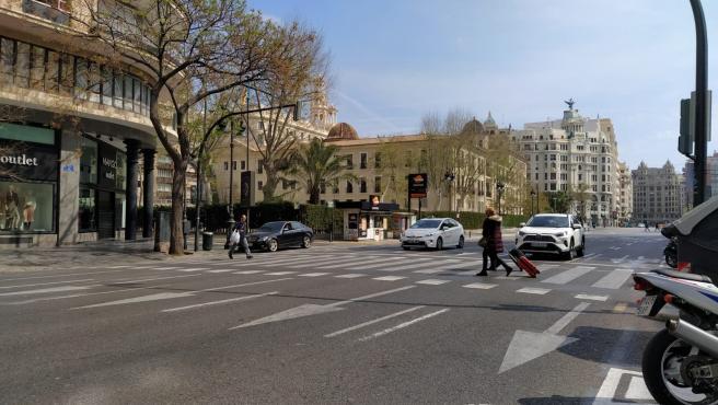 Imatge d'un carrer de la ciutat de València després de decretar-se l'estat d'alarma per la crisi del coronavirus.