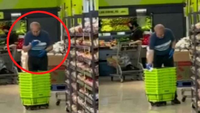Empleado de un supermercado limpiando cestas con su saliva.