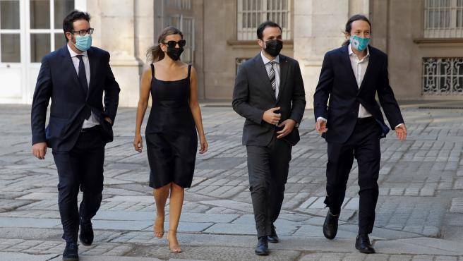 El vicepresidente segundo del Gobierno Pablo Iglesias y los ministros Alberto Garzón y Yolanda Díaz a su llegada al Palacio Real