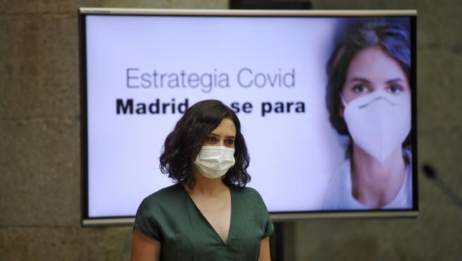 La presidenta de la Comunidad de Madrid, Isabel Díaz Ayuso, presenta la estrategia de continuidad del Covid-19, en la que informa de las nuevas medidas que pondrá en marcha el Gobierno regional para combatir al coronavirus, en la Casa de Correos, Madrid (