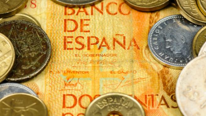Determinados billetes y monedas de peseta tienen mucho valor entre los coleccionistas.