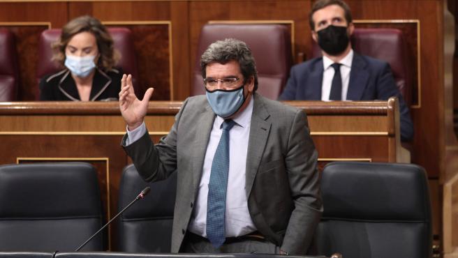 El ministro de Seguridad Social y Migraciones, José Luis Escrivá, interviene en una nueva sesión de control al Gobierno en el Congreso de los Diputados, en Madrid, (España), a 30 de septiembre de 2020.