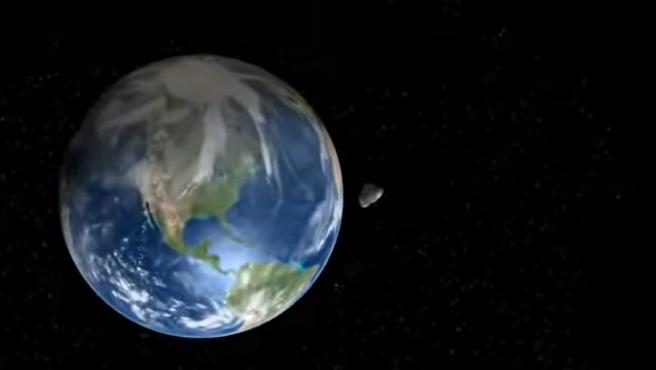 Recreación por ordenador del paso del asteroide 2020 VT4 junto a la Tierra.