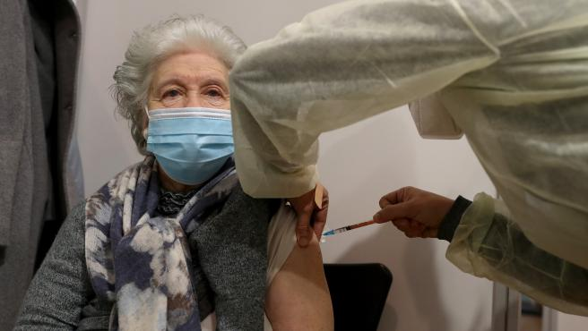 A woman receives a first dose of the Pfizer-BioNTech Covid-19 vaccine at Sao Domingos de Rana sports complex, in Cascais, Portugal, on February 18, 2021. Portugal continues with the first phase of inoculation against COV