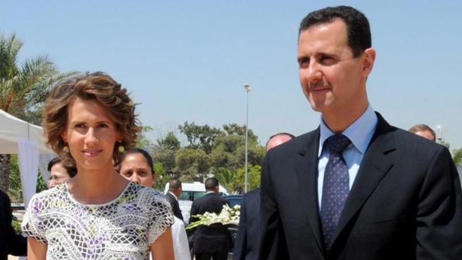 El presidente sirio, Basar al Asad y su esposa Asma.