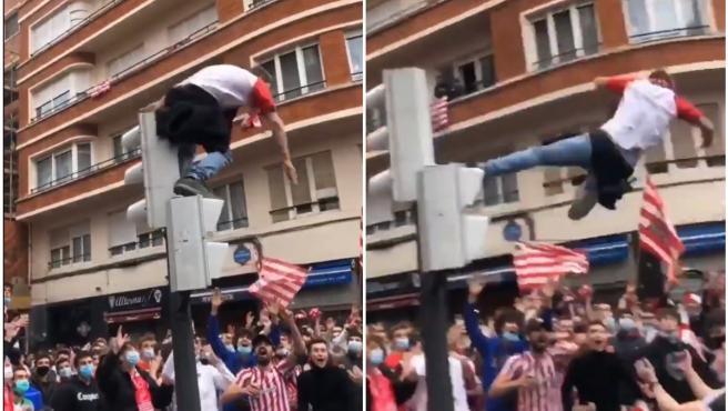 Un aficionado del Athletic Club salta desde un semáforo.
