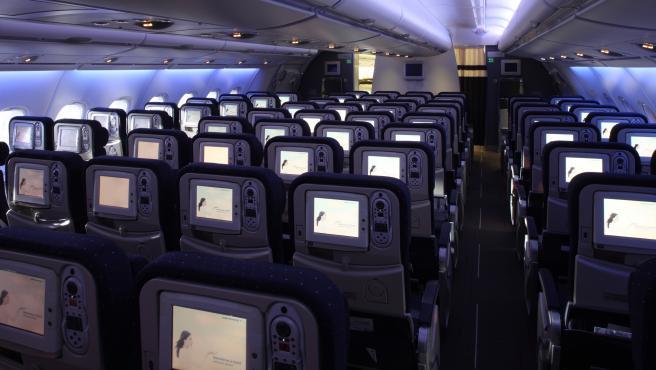 Archivo - Asientos de un avión.