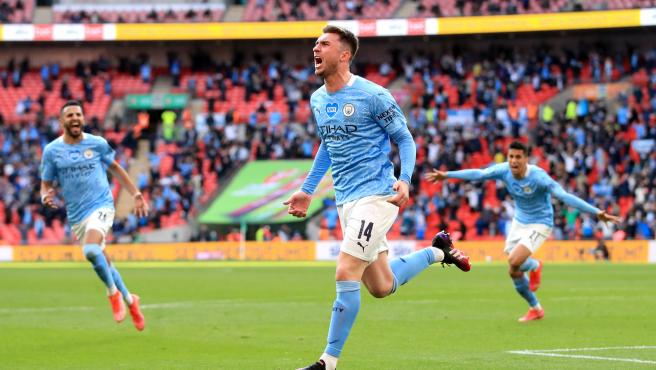 Aymeric Laporte celebrates a goal with Manchester City.