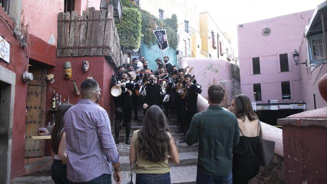 A female student, the Mexican equivalent of the tunas, performs on a street in Guanajuato.