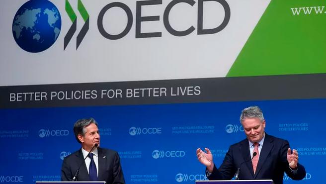 El secretario de estado de EE UU, Anthony Blinken, y el secretario general de la OCDE, Mathias Cormann.