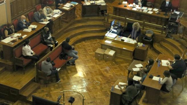 Los cuatro acusados en el juicio por matar y quemar a una mujer en Begues (Barcelona).