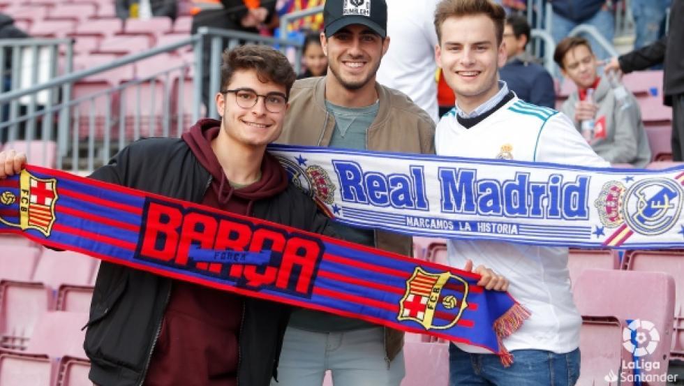 Aficionados del Barcelona y el Real Madrid.